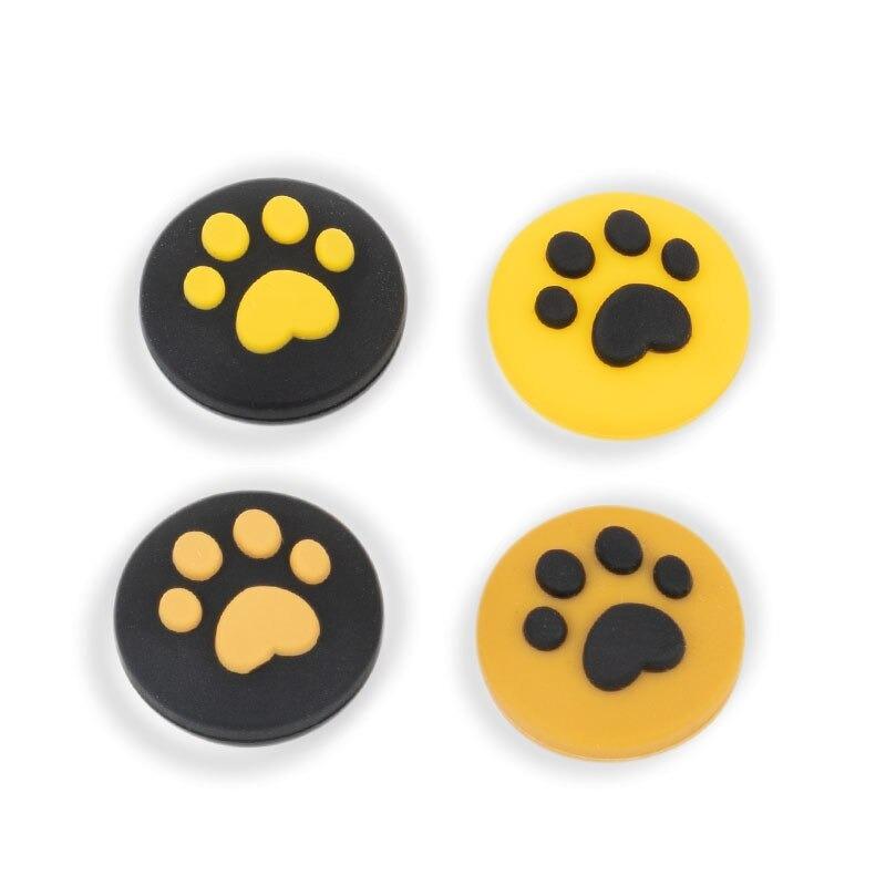 paw-thumb-grips-black-yellow