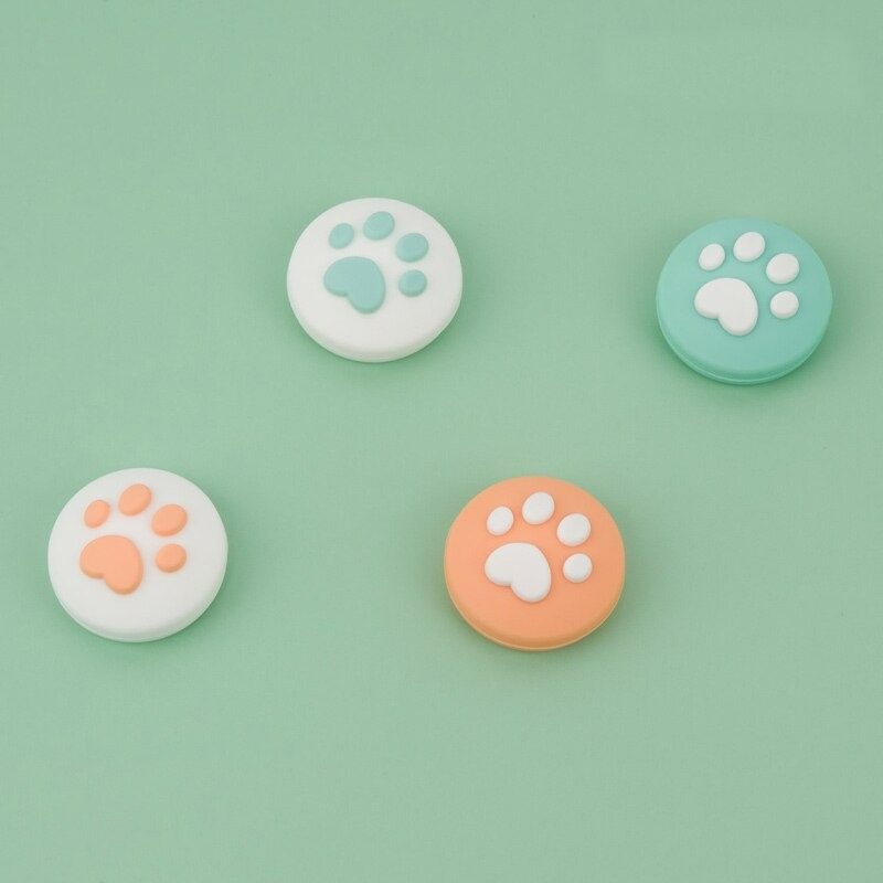 paw-thumb-grips-orange-green