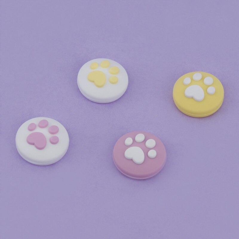 paw-thumb-grips-purple-yellow